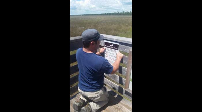 Installing the Habitat Watch sign