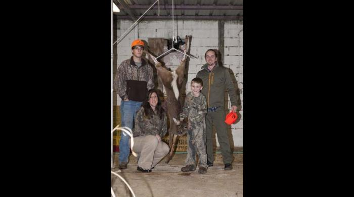 A successful youth hunter, his guide and his family.