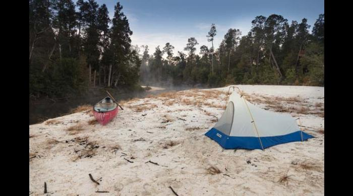 Pitching a tent on one of the sandbars located in front of a shelter is also an option.